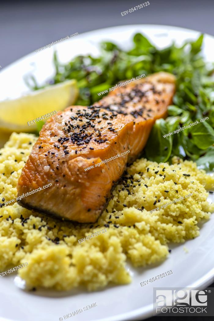Stock Photo: baked salmon with spinach salad and couscous.