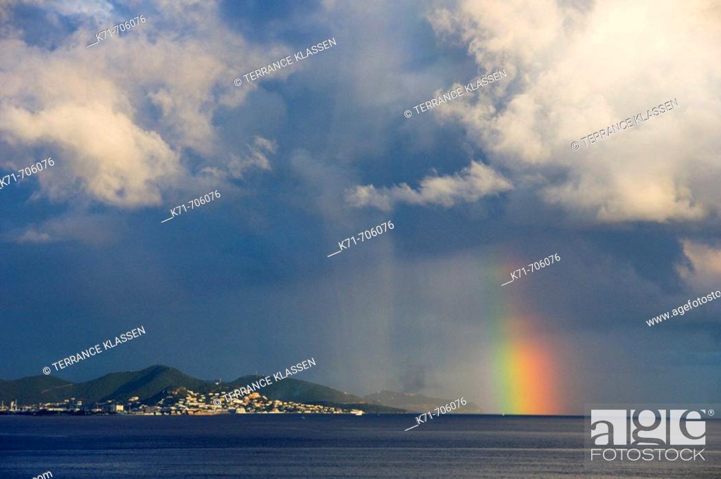 Stock Photo: Storm clouds and rainbow over Sint Maarten, Netherland Antilles.