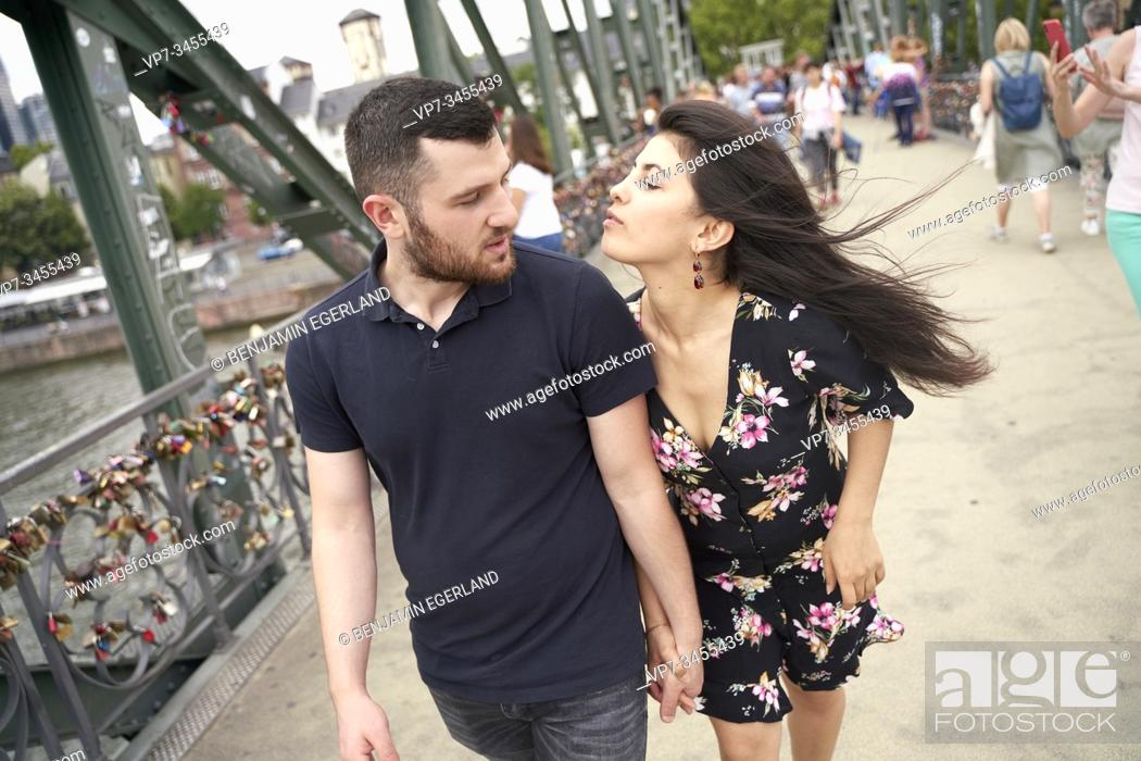 Photo de stock: Young couple walking on bridge. Eisener Steg, Frankfurt am Main, Germany.