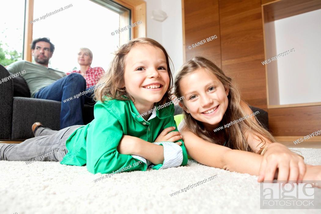 Stock Photo: Germany, Bavaria, Nuremberg, Girl and boy smiling, portrait.