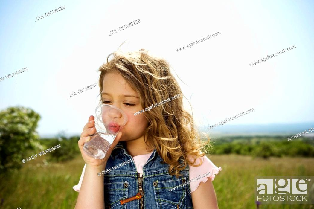 Stock Photo: Girl drinking water.