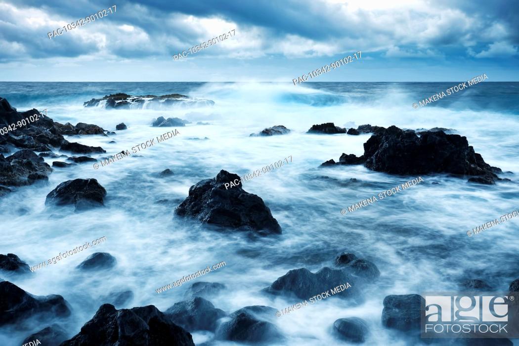 Stock Photo: Hawaii, Maui, Kipahulu, Dramatic stormy ocean coastline at sunrise.