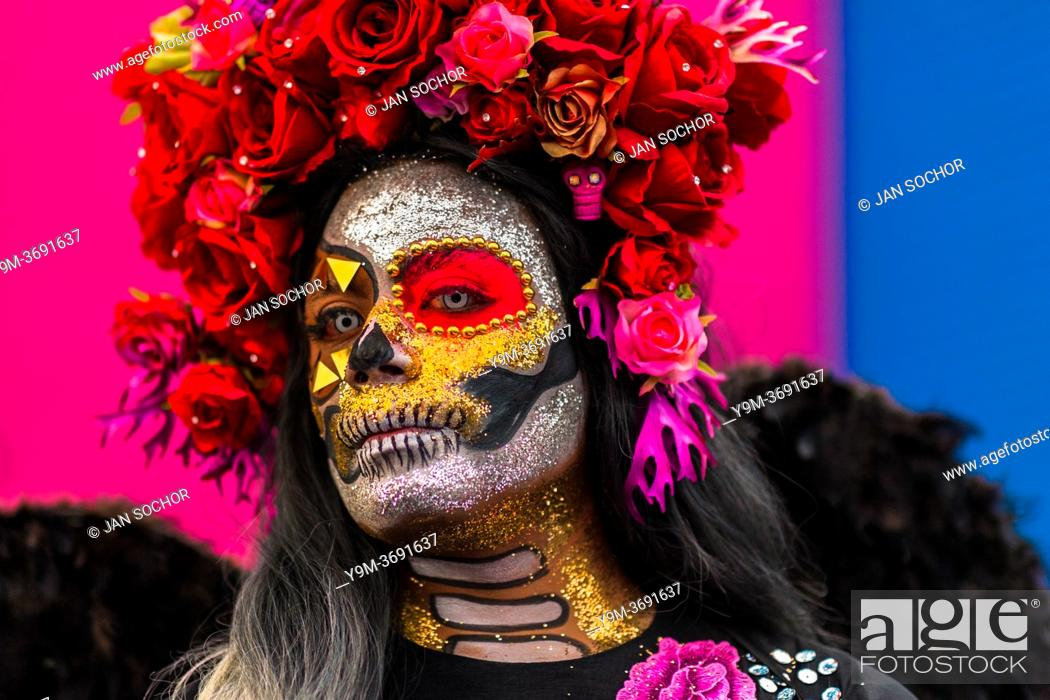 Stock Photo: A young Mexican woman, dressed as La Catrina, a Mexican pop culture icon representing the Death, takes part in the Day of the Dead festivities in Oaxaca, Mexico.