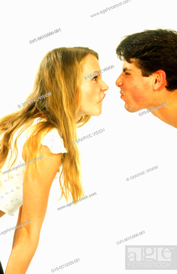 Stock Photo: Young couple making faces at each other.
