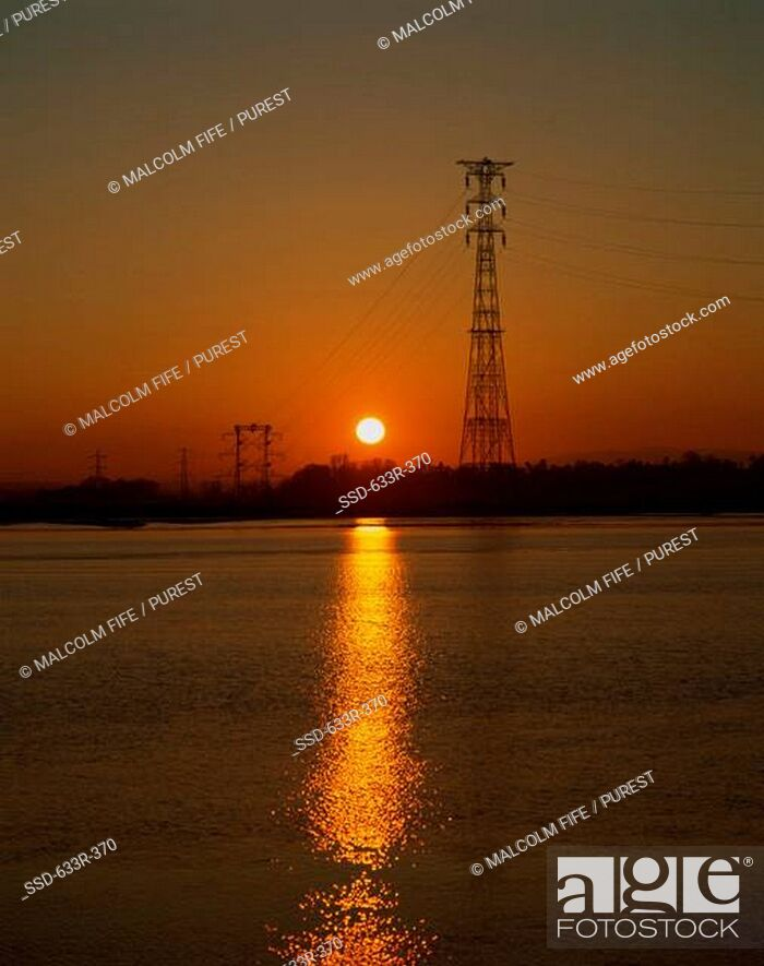 Stock Photo: Electricity pylon across River Forth during sunset, Kincardine, Scotland.
