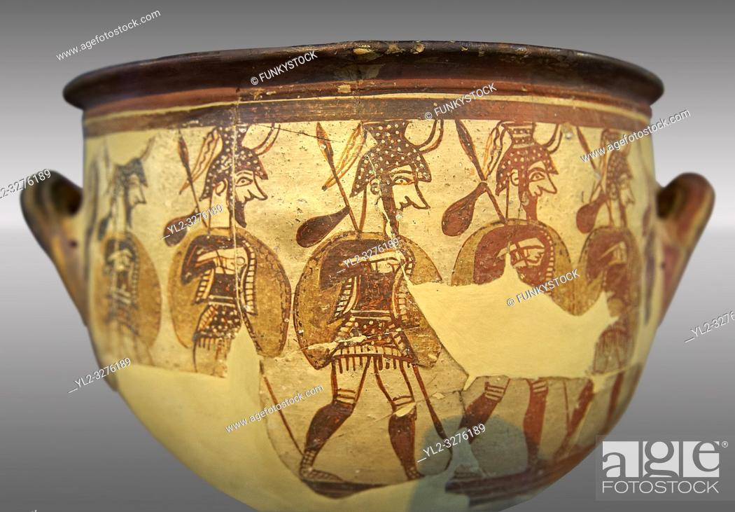 """Imagen: Large wine krater known as """"House of the Warrior Vase"""", showing men in full armour ( helmet, cuirass, greaves, shield and spear ) as they depart fro war with a."""