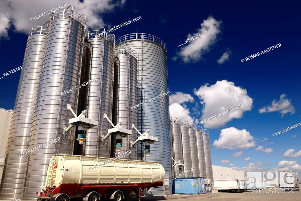 Stock Photo: Large stainless steel tanks and trucks containing plastic ingredients for extrusion industry.