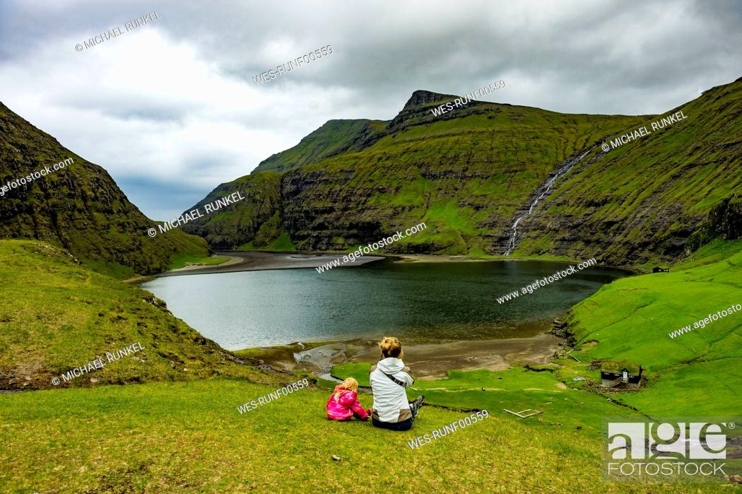 Stock Photo: Denmark, Faroe islands, Streymoy, Woman with her daughter looking to fjord of Saksun.