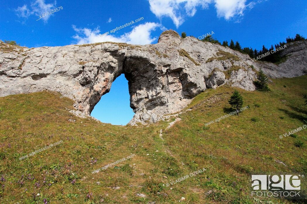 Stock Photo: The rock arch 'Okno' at the natural reserve Ohniste, Janska dolina in Nizke Tatry mountains, Slovakia.
