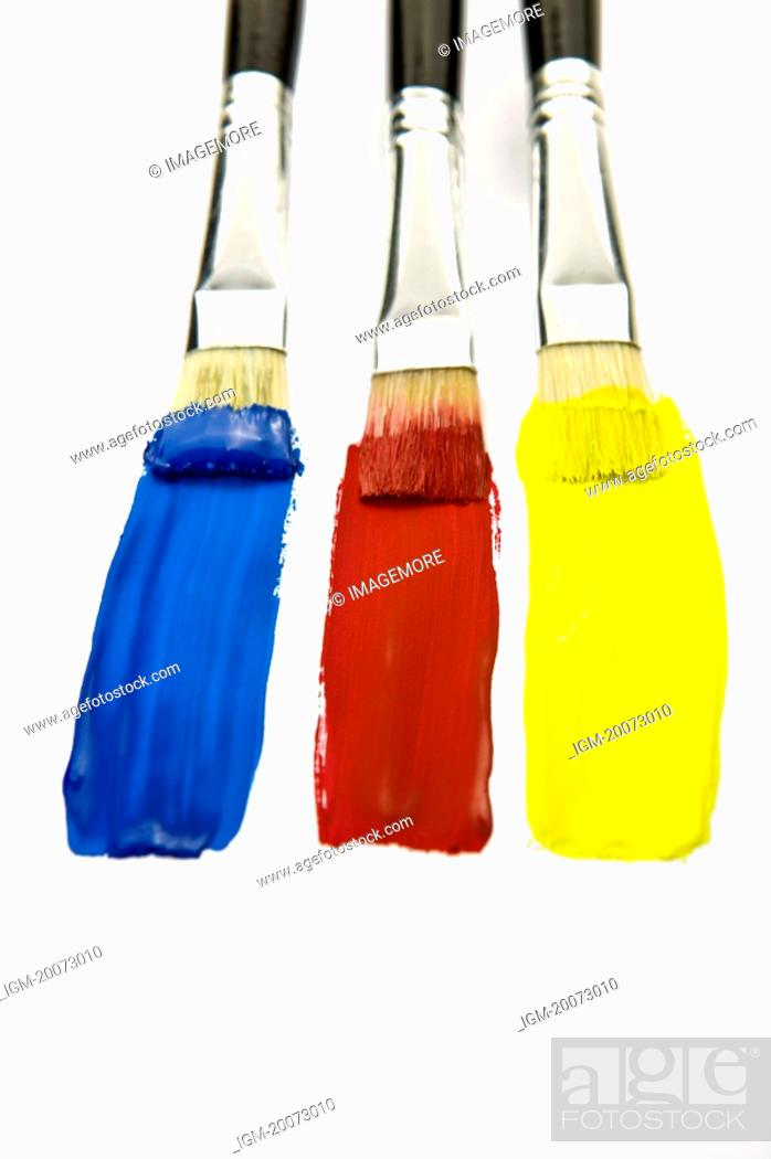 Stock Photo: Three Paintbrushes with colors of Blue, Red, and Yellow.