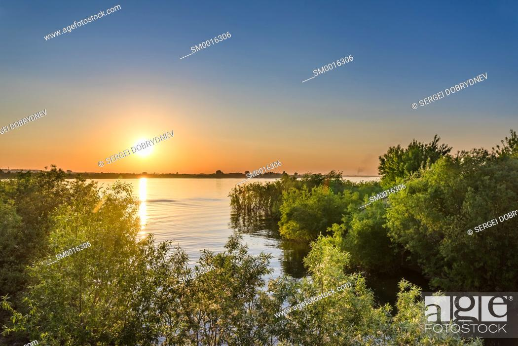 Stock Photo: Sunset over the river on a warm spring evening.