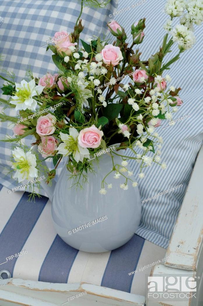 Stock Photo: Tearoses, love-in-a-mist and baby's breath.