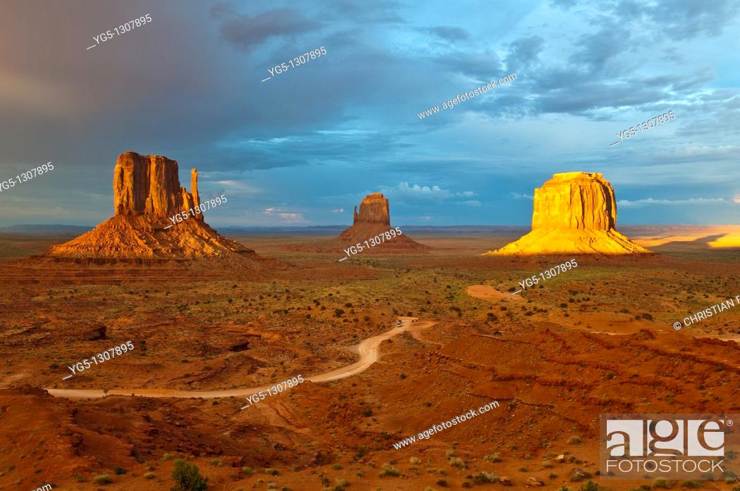 Stock Photo: The Mitten Buttes in the last light during a storm, Monument Valley, Arizona, USA.