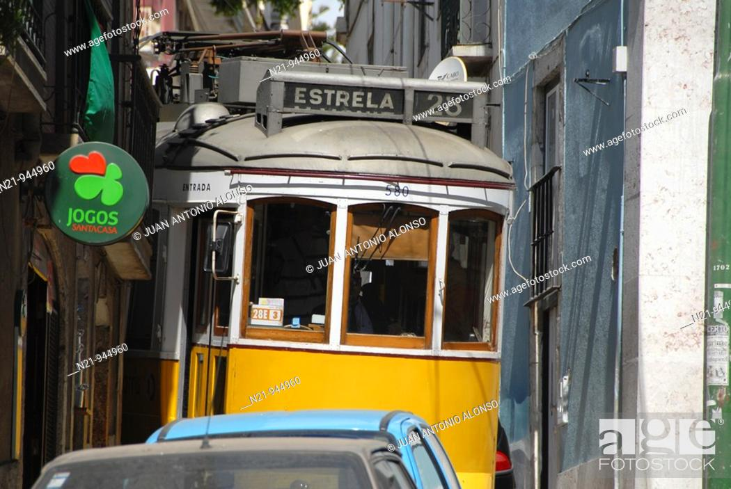 Stock Photo: The popular tram 28 through the winding and narrow streets of Alfama. Lisbon, Portugal.