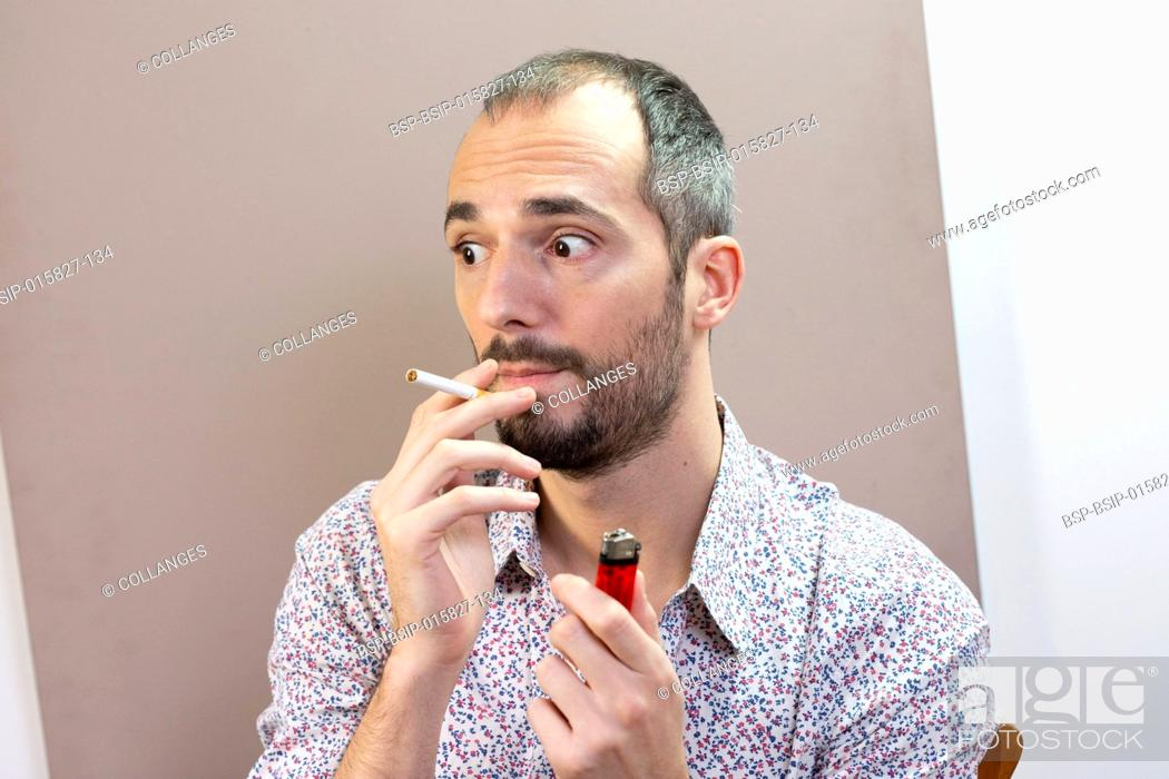 Stock Photo: A man who is tempted to smoke again having given up smoking.