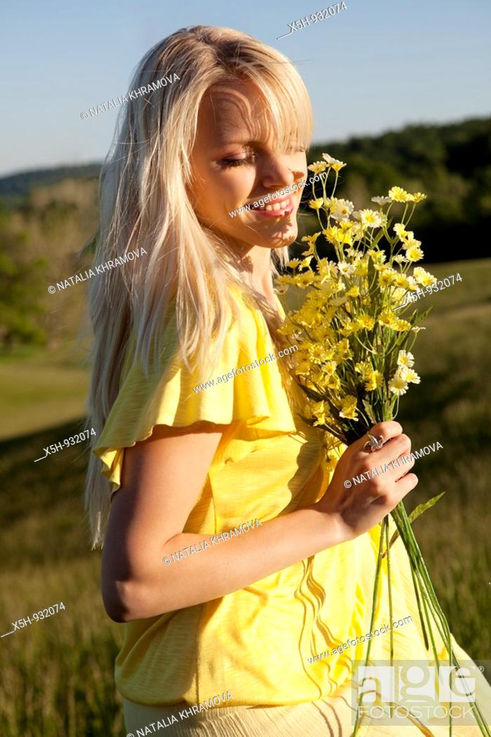 Stock Photo: one young woman with flowers.