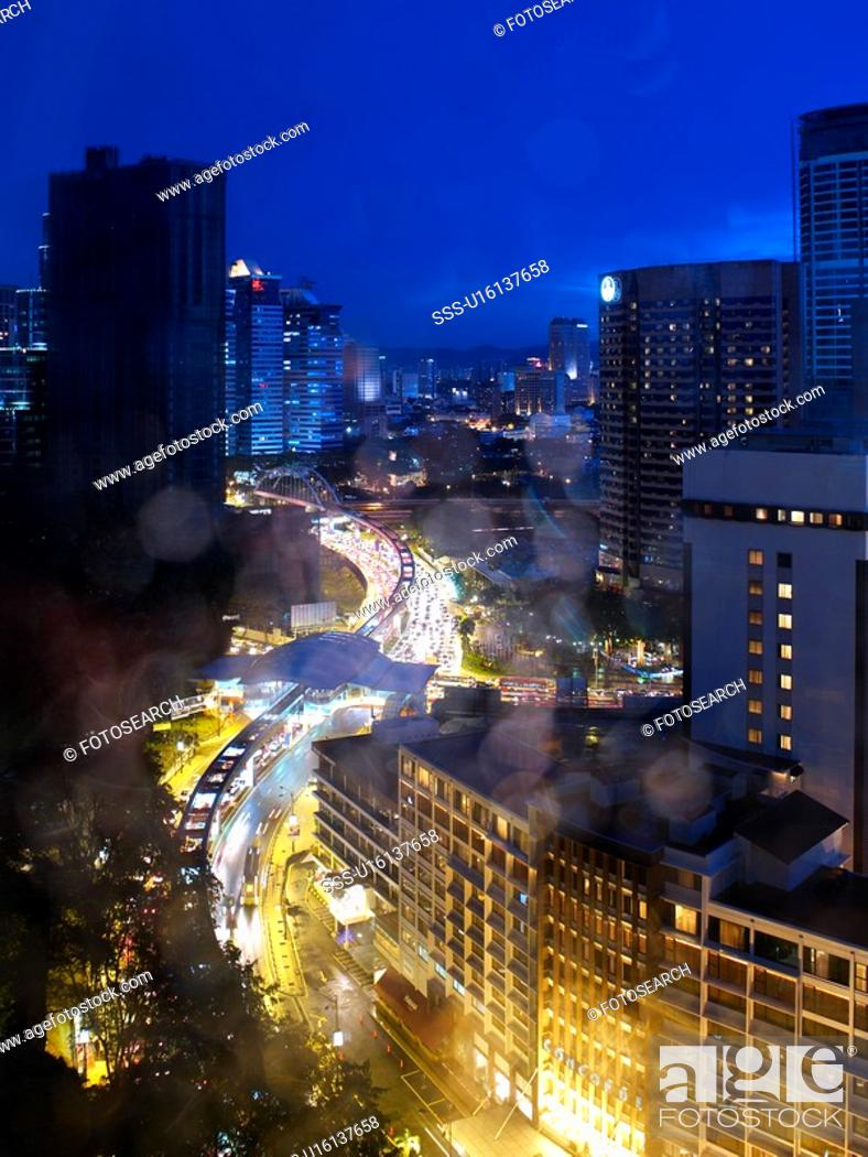 Stock Photo: Malaysia, Kuala Lumpur, Cityscape through window.