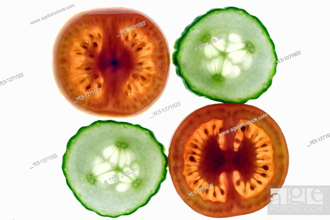 Stock Photo: Cucumber and Tomato slices close up.