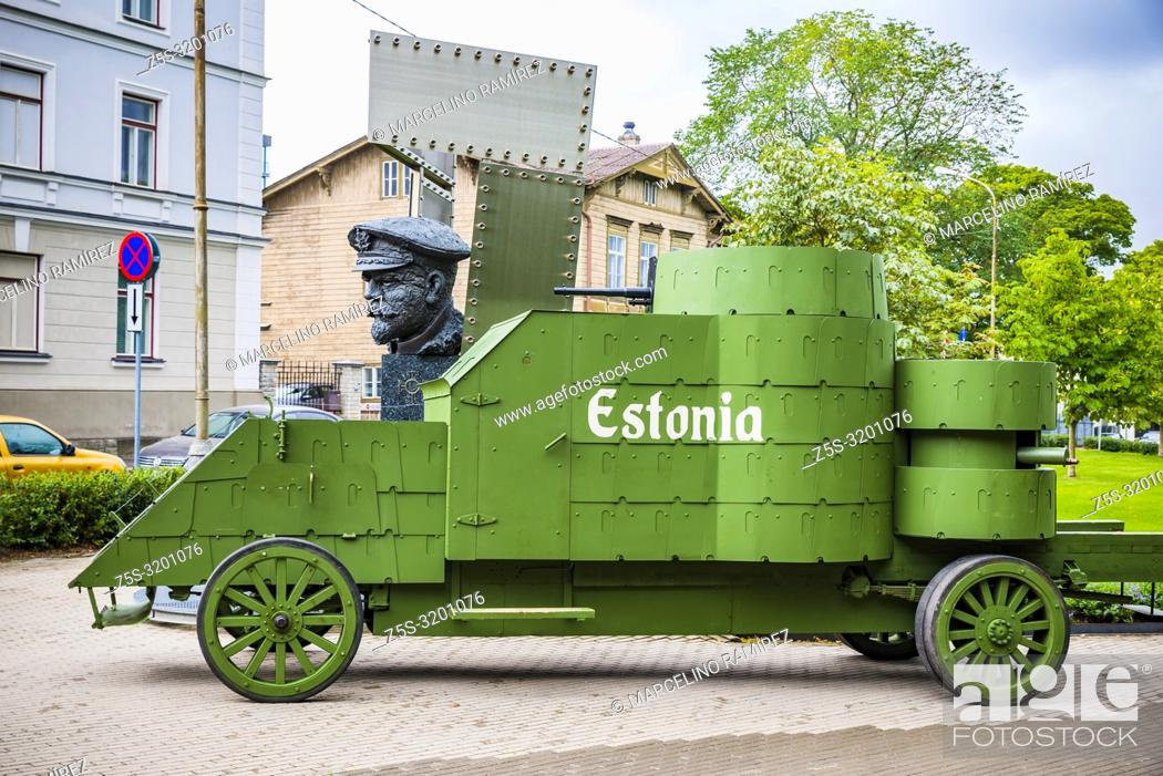 Stock Photo: Estonia, the first armored vehicle built in the country and bust of Admiral Pitka, Estonian military commander from the Estonian War of Independence until World.