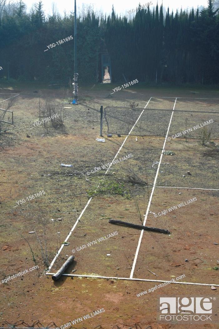 Stock Photo: abandoned derelict tennis court.
