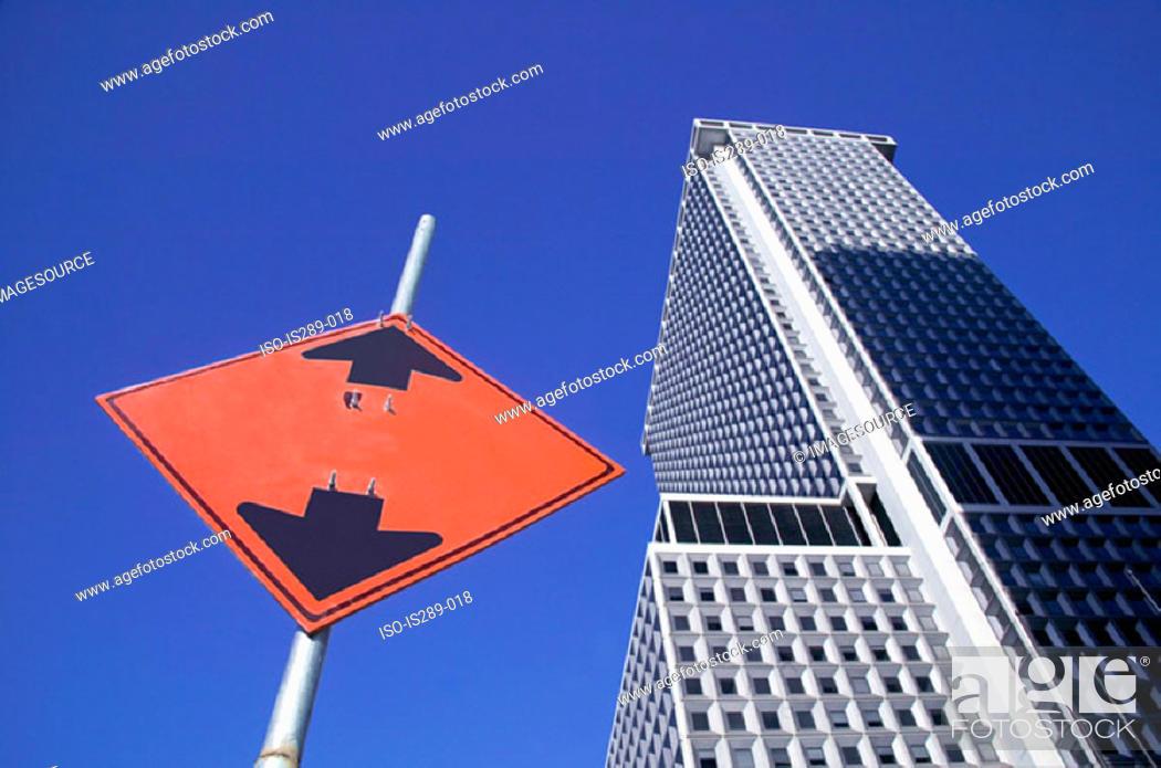 Stock Photo: Road sign and skyscraper.