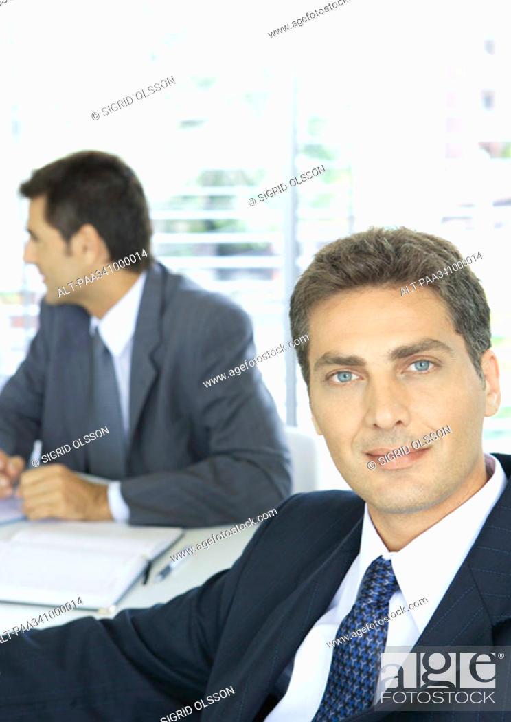 Stock Photo: Businessman smiling, portrait.