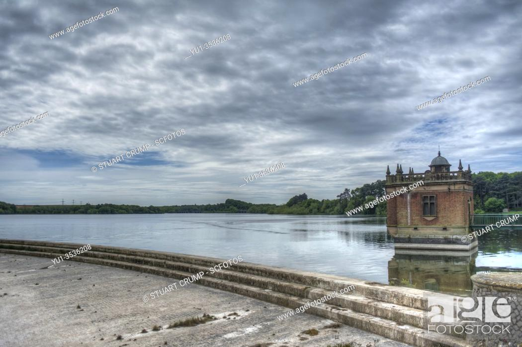 Stock Photo: HDR image of cloud formation over the draw off tower at Swithland Reservoir in Leicestershire.