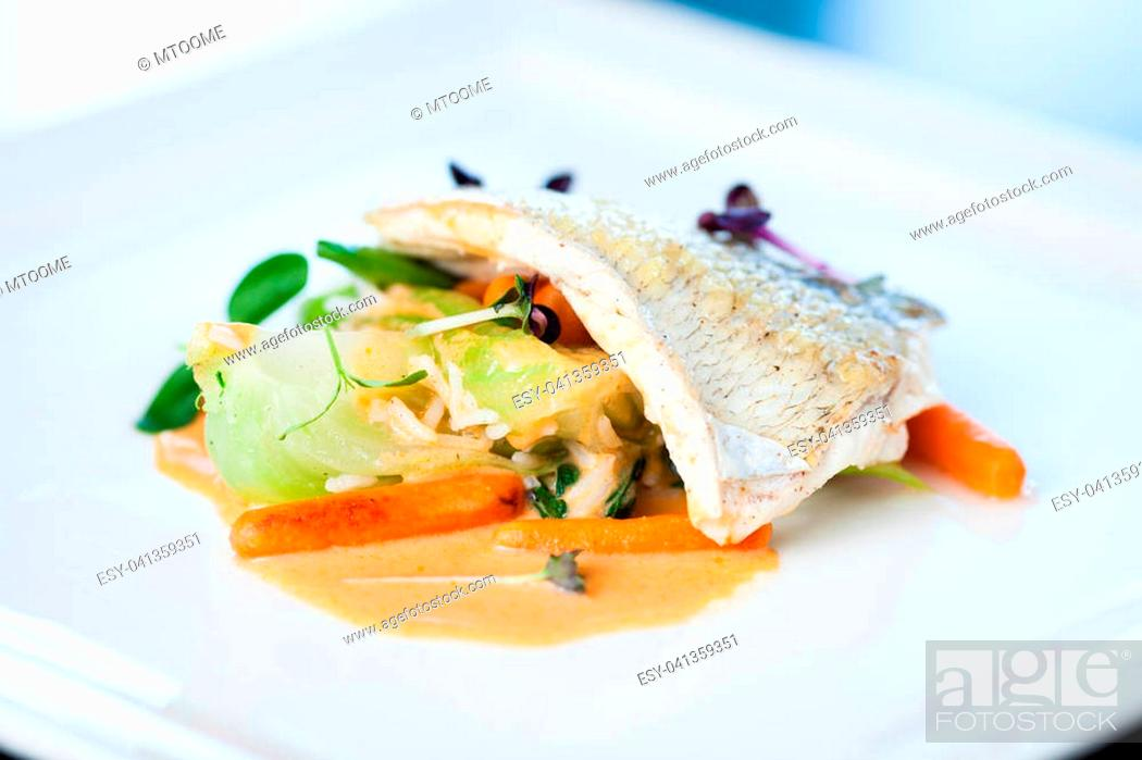 Stock Photo: Fried whitefish fillet stir-fried with green vegetables, jasmine rice, carrot salad and a creamy shrimp sauce.