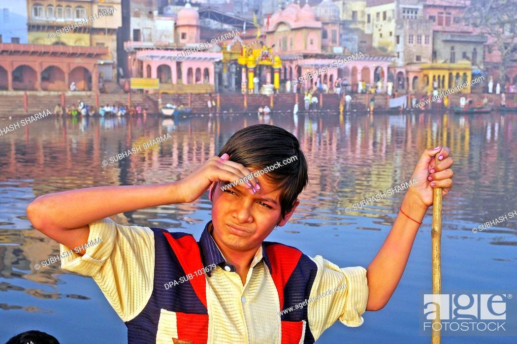 Stock Photo: Indian boy in boat ; Vishram Ghat ; Mathura ; Uttar Pradesh ; India.