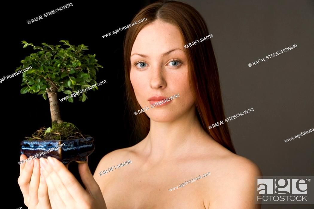 Stock Photo: beauty woman with bonsai tree.
