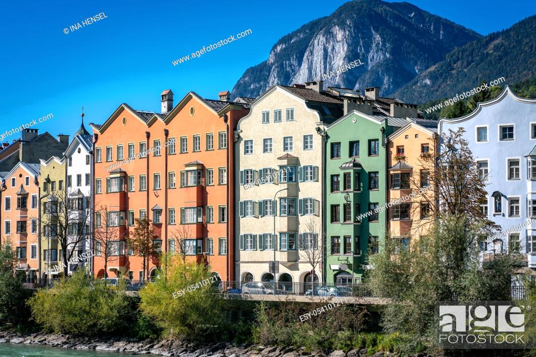 Stock Photo: Panoramic view of colourful buildings in the austrian town Innsbruck with the river Inn in the foreground and mountainsof the alps in the background on a sunny.