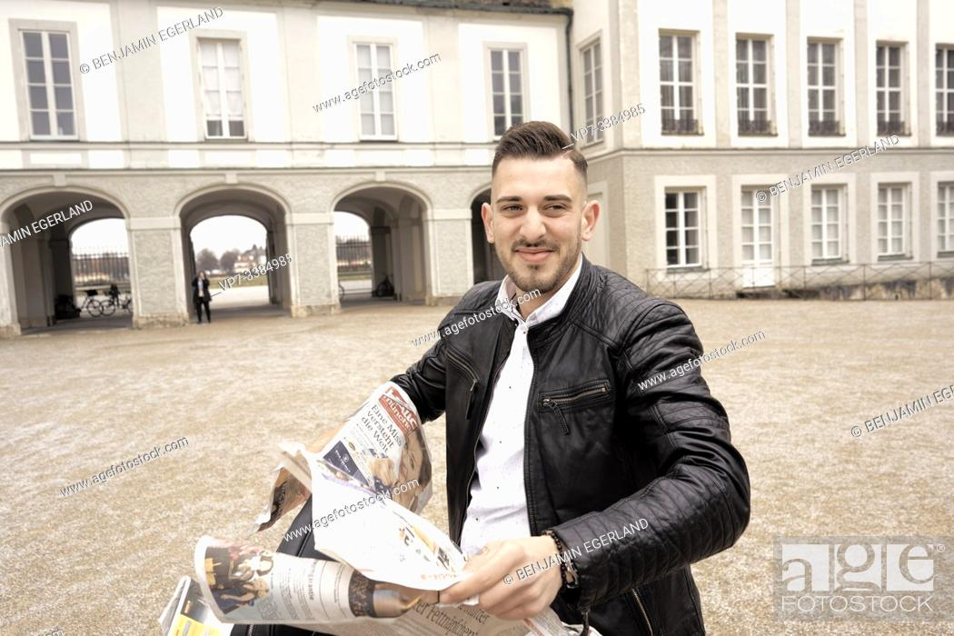 Stock Photo: Man with dismantled newspaper, in Munich, Germany.