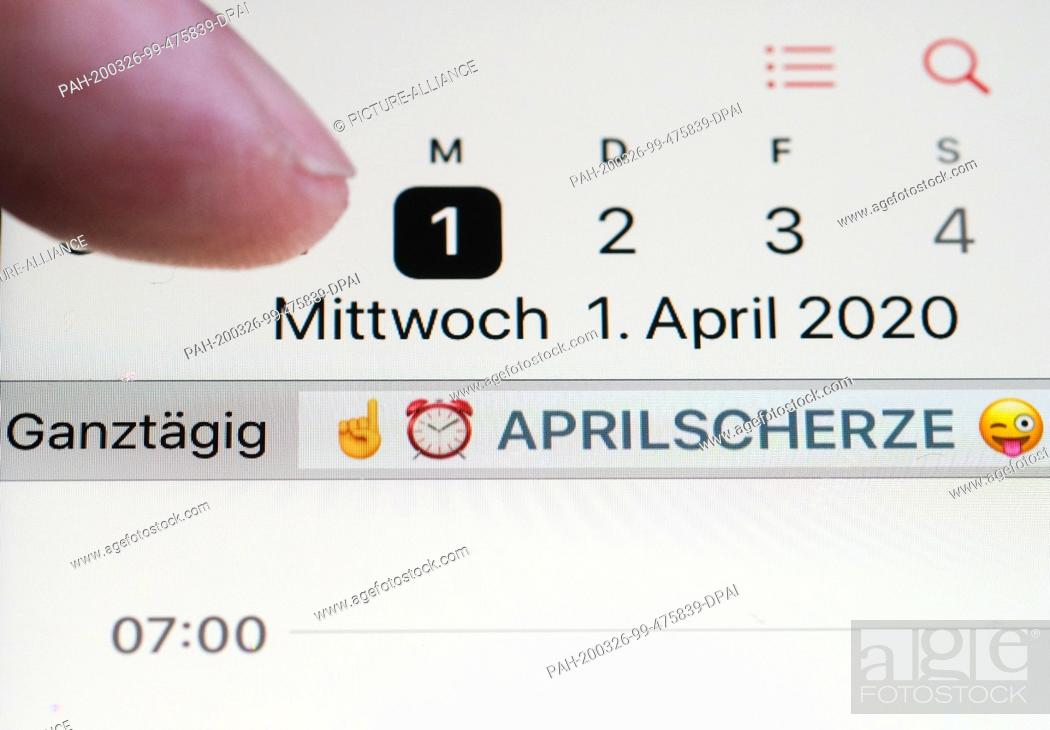 """Stock Photo: ILLUSTRATION - 25 March 2020, Berlin: On the display of a smartphone, warning emojis and the note """"""""April Fools' Day"""""""" are stored in the calendar on April 1st."""