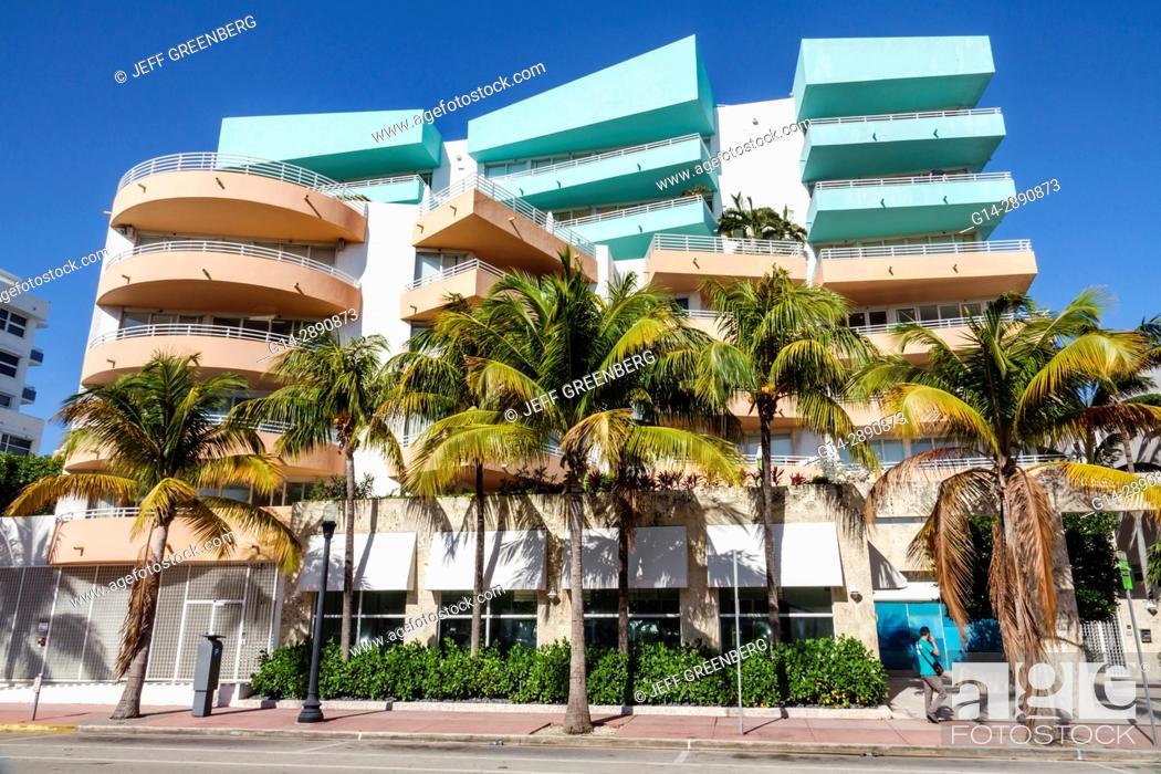 Stock Photo: Florida, Miami Beach, South Beach, Ocean Drive, Ocean Place, condominium, building, balconies, architecture, palm trees, pastel colors,.