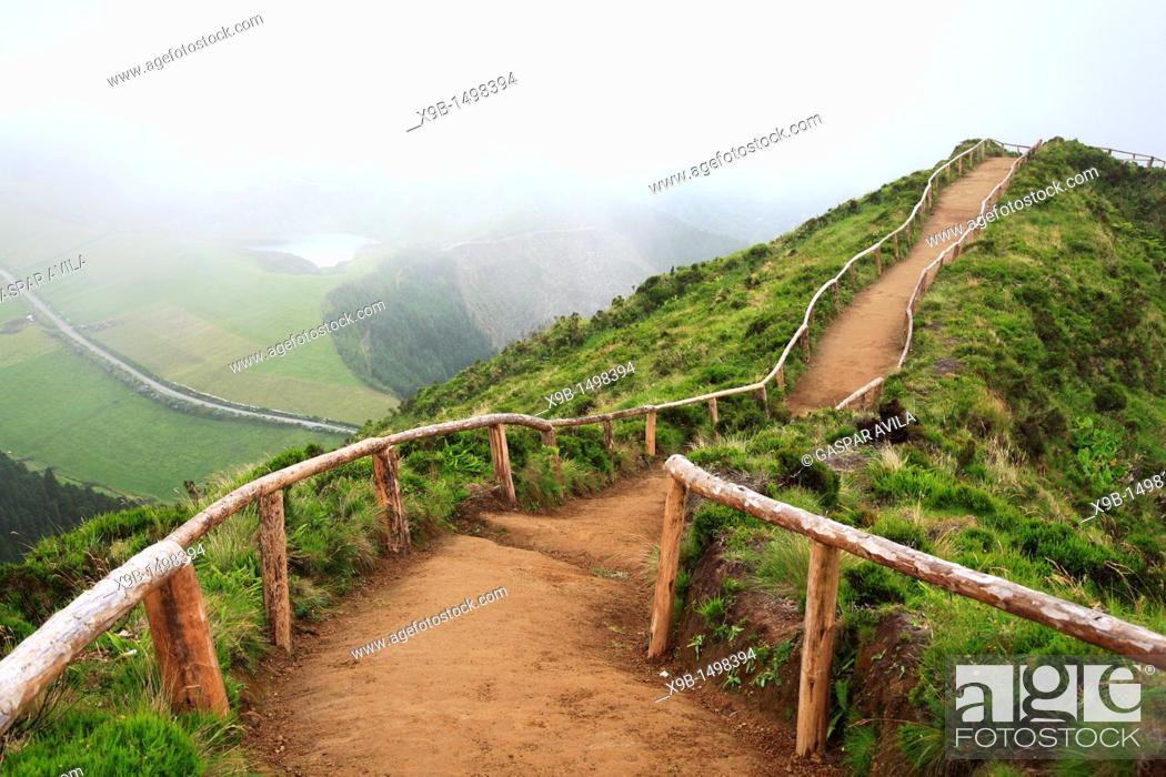 Stock Photo: Empty walking trail in foggy weather nearby Sete Cidades crater  Sao Miguel island, Azores, Portugal.