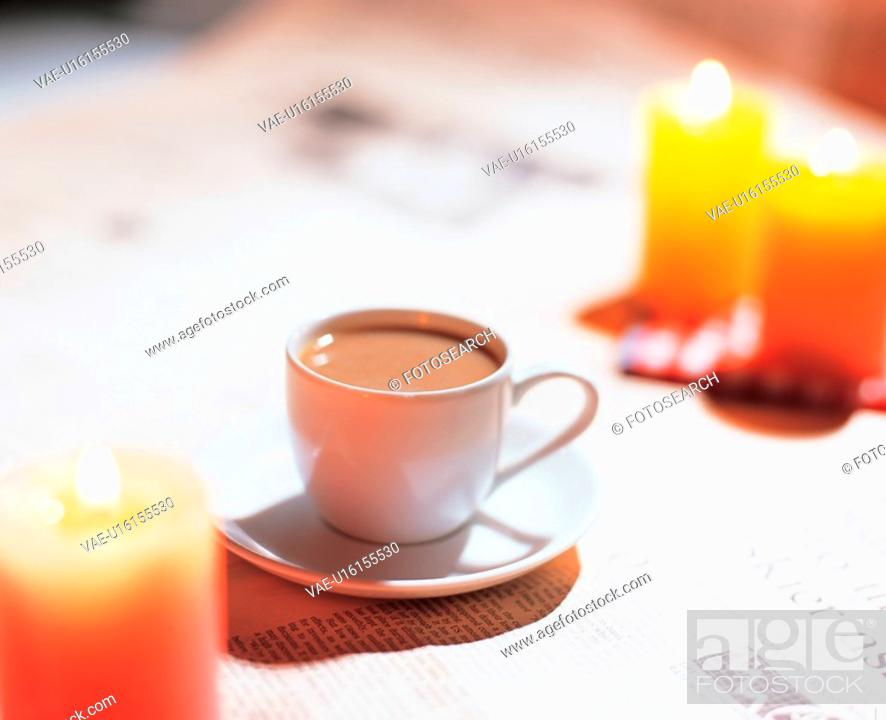 Stock Photo: newspaper, coffee, candlelight, candle, teacup, aromatic, tea.