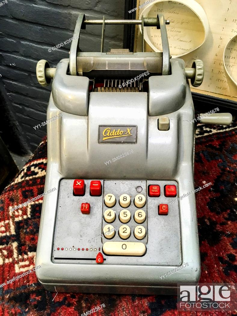 Stock Photo: Tilburg, Netherlands. A vintage, mechanical calculator, branded: 'Ciddo' inside a retrospective collection of industrially produced products.