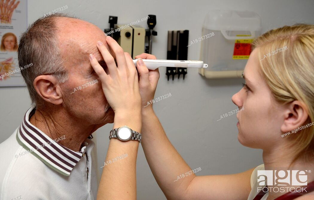 Stock Photo: A patient undergoes a healthy eye screening for cataracts, glaucoma, diabetes, macular degeneration and dry eye.