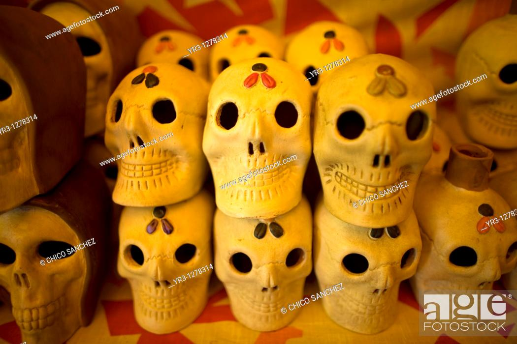 Stock Photo: Ceramic skulls sit for sale ahead of Day of the Dead celebrations in a shop at the Jamaica Flower Market in Mexico City.