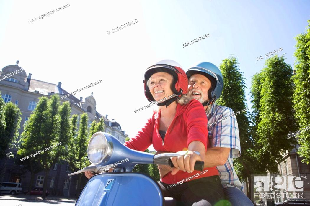 Stock Photo: Couple on scooter.