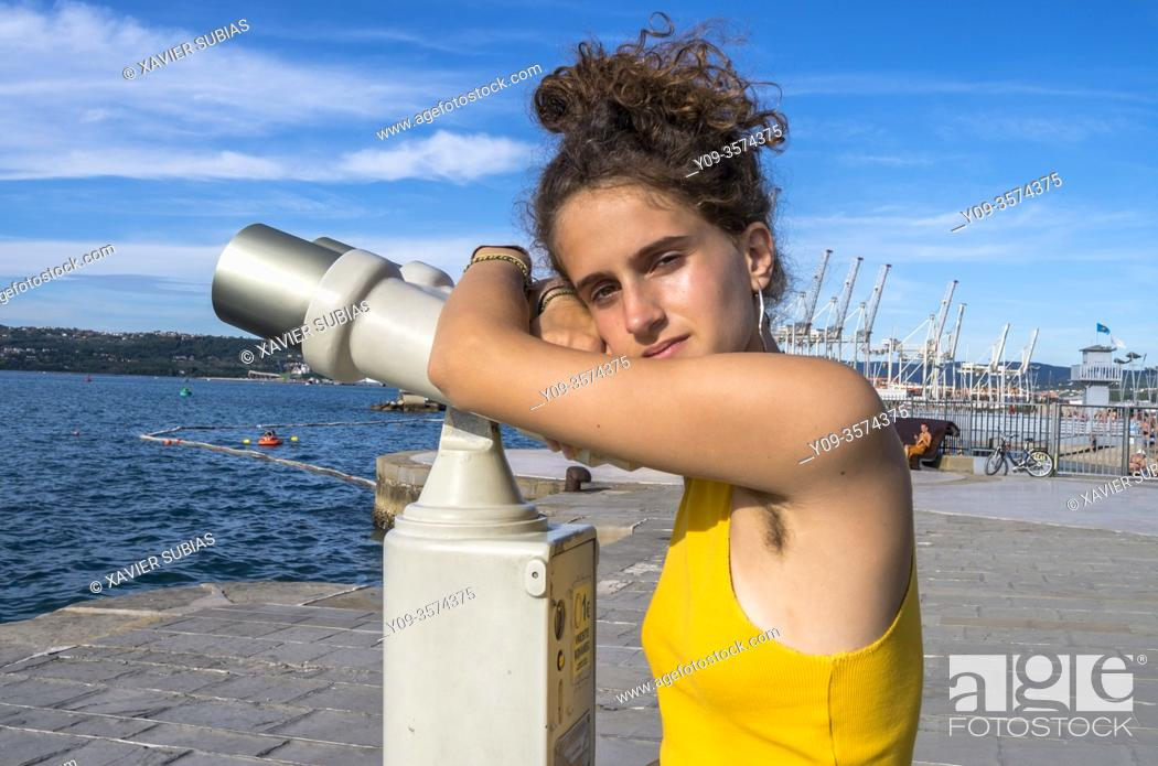 Stock Photo: Girl looking through binoculars, Koper, Slovenia.