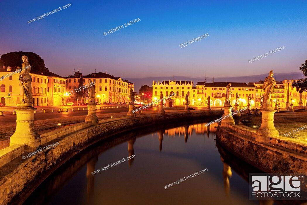 Stock Photo: Illuminated Prato della Valle with statues at dusk.