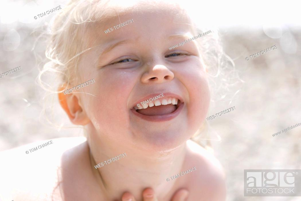 Stock Photo: Germany, Bavaria, Girl smiling, portrait.