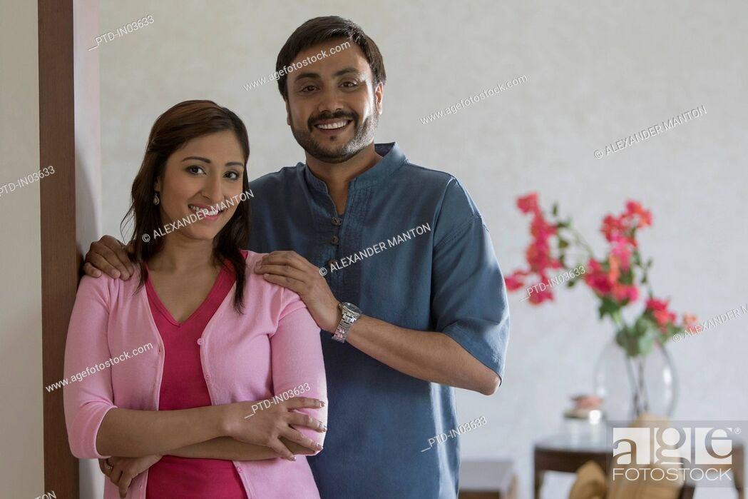 Stock Photo: Woman and man arms folded looking at camera smiling.