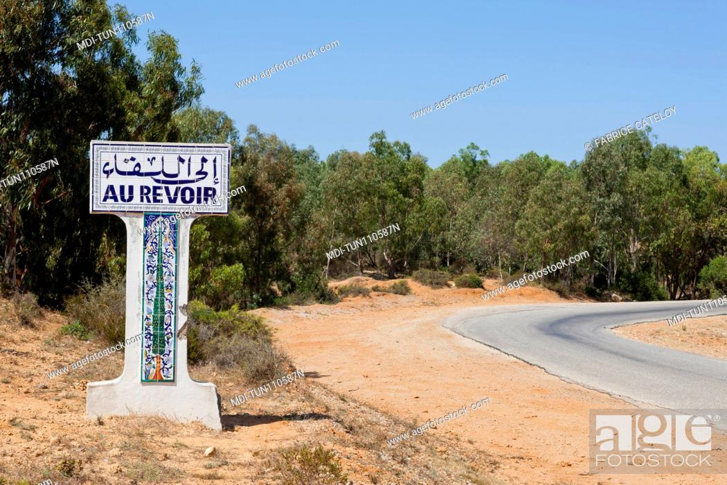 Stock Photo: Tunisia - Cap Bon - Road sign Au Revoir when leaving a village on the Korbous road.