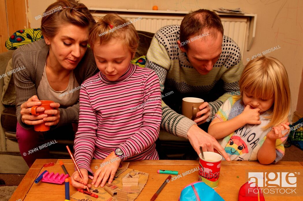Stock Photo: Parents and children crafting.