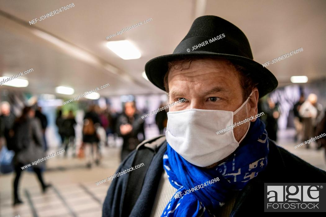Stock Photo: Man wearing protective mask.