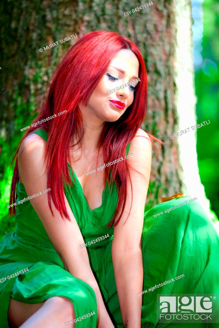 Stock Photo: Redhead in the forest.