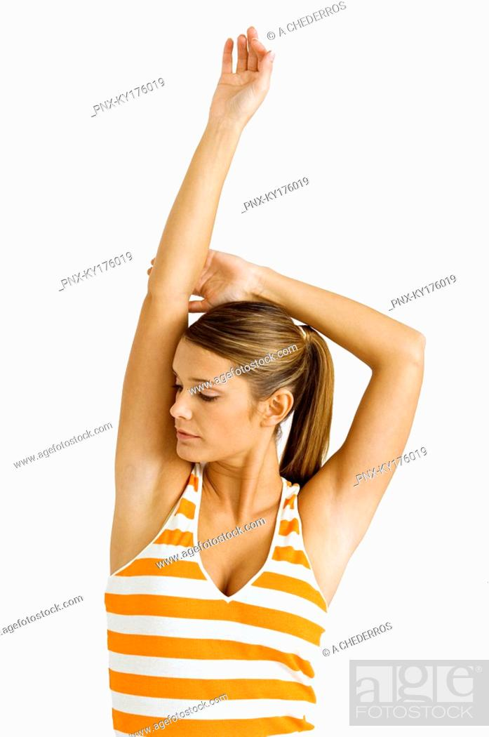 Stock Photo: Close-up of a young woman stretching.