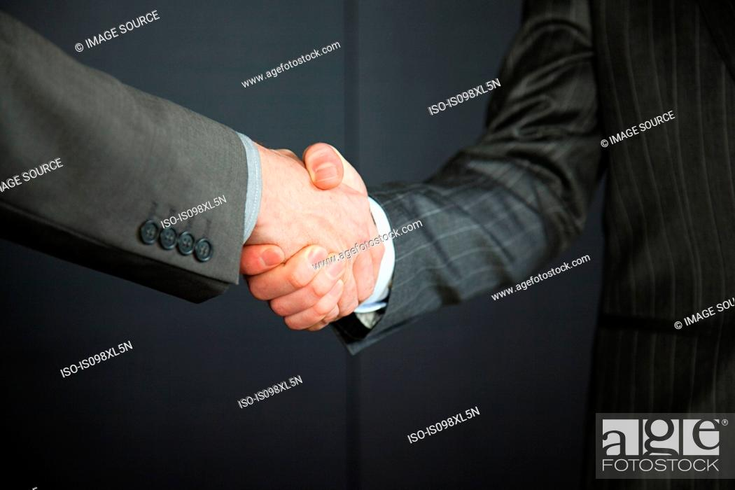 Stock Photo: Two businessmen shaking hands.